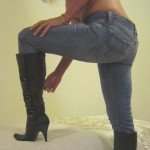 Giselle in jeans taking off her boots